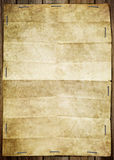 Vintage background with old paper. Stick paper on wooden wall Royalty Free Stock Photo
