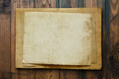 Vintage background with old paper and letters on wood Royalty Free Stock Photos
