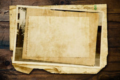Vintage background with old paper and letters on wood Royalty Free Stock Photography