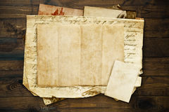 Vintage background with old paper and letters on wood Stock Image
