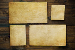 Vintage background with old paper and letters on wood Stock Photography