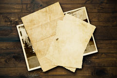 Vintage background with old paper and letters on wood Royalty Free Stock Image