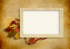 Vintage background with old photo frame. And with autumn leaves Stock Photos
