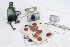 Vintage background with old pocket watch, old ink pen, handwritten letters and old ink pot. Background Stock Photography