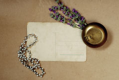 Vintage background with old postcard bouquet of lavender. And Jewelry Royalty Free Stock Image