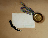 Vintage background with old postcard, snuffbox, bouquet of lavender and  feathers Stock Photography