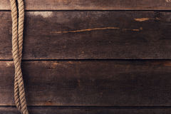Vintage background with old rope on wood planks. Vintage background with old rope on brown wood planks Royalty Free Stock Image
