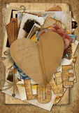 Vintage background with paper heart and old postcards and photos Royalty Free Stock Photography
