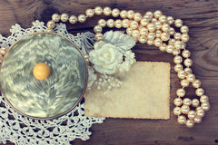 Vintage background with pearl powder box Royalty Free Stock Images
