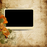 Vintage background with photo-frame and faded roses Royalty Free Stock Photos