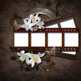 Vintage background with photo-frame and film strip. Vintage background with photo-frame, lily, butterfly and film strip Stock Photography