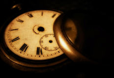 Vintage background with a pocket watch Stock Photo