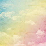 Vintage background. In the rainbow color shade with clouds,blue sky view with Stock Illustration