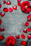 Vintage background with red hearts and rose petals, top view,frame. Valentines day card Stock Photos