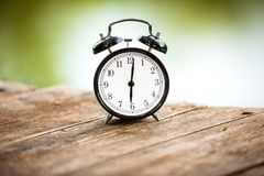 Vintage background with retro alarm clock Royalty Free Stock Images