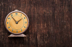Vintage background with retro alarm clock Stock Photography