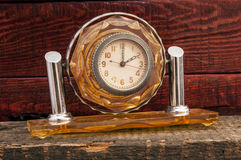 Vintage background with retro alarm clock on table Stock Images