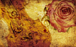 Vintage background with rose and notes. Vintage grunge background with rose and music notes Stock Photography