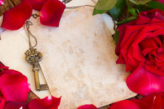 Vintage background with rose petals  and key Royalty Free Stock Image