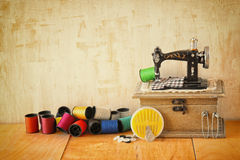 Vintage Background with sewing tools and sewing kit over wooden textured background Stock Photos