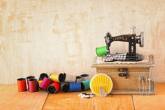 Vintage Background with sewing tools and sewing kit over wooden textured background Stock Photo