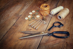 Vintage Background with sewing tools and sewing kit over wooden textured background Stock Photography