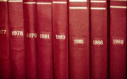 Vintage background from stack of old books, arranged vertically. Collected works. Toned stock photos