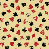 Vintage background with suits of playing cards. Royalty Free Stock Photos