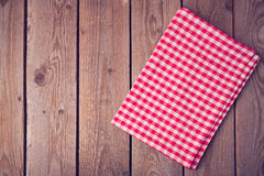 Vintage background with tablecloth on wooden table. View from above Stock Photography