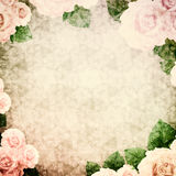 Vintage background vignette with roses. An ancient background with flower corners. Basis for design or text Royalty Free Stock Photo