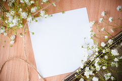 Background with white flowers, antique tray. Vintage background with white flowers, antique tray and a cardboard on a wooden board Royalty Free Stock Image