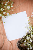 Background with white flowers, antique tray. Vintage background with white flowers, antique tray and a cardboard on a wooden board Stock Photo
