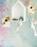 Vintage background with wooden birds Stock Image