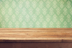 Vintage background with wooden deck table and classical wallpaper Royalty Free Stock Photos