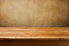 Vintage background with wooden deck table on a grunge wall Stock Photos
