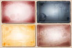 Vintage backgrounds. Four Vintage backgrounds with ragged edges Stock Images