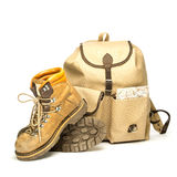 Vintage backpack and hiking boots. Studio shot of vintage hiking boots, a vintage backpack made of canvas and an old map Royalty Free Stock Photos