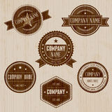 Vintage Badges On Wood Background Stock Image