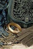 Vintage bag, leather gloves, bracelets and scarf. Closeup stock images