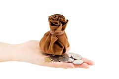 Vintage bag of money. On hand with coins isolated Royalty Free Stock Photography