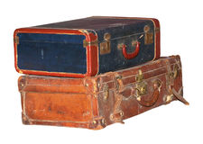 Vintage Baggage. Two pieces of old luggage piled up royalty free stock image