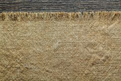 Vintage bagging textile on wooden board Royalty Free Stock Photos