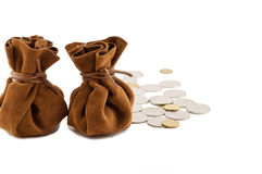 Vintage bags money. Vintage bag money on hand with coins isolated Stock Photos