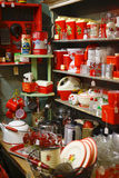 Vintage Bakelite kitchenware. Many of these red kitchen items are made of early plastic called Bakelite.  It is very retro and stylish today Royalty Free Stock Image