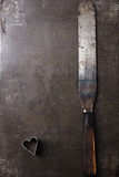 Vintage  Baking utensils - spatula and heart shape cutter Stock Photos
