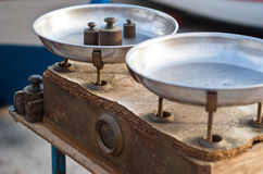 Vintage balance scale. Vintage kitchen scales with brass weights Royalty Free Stock Images