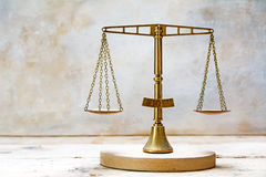 Vintage balance scales of justice made of brass Royalty Free Stock Images