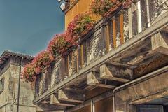 Vintage balcony  with fuchsia petunias Royalty Free Stock Photos