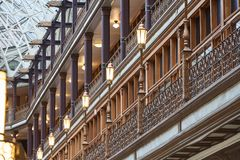 Vintage Balcony in Victorian Building. Cleveland, Ohio/USA: Lampposts lining a balcony in the Old Arcade in Downtown Cleveland. Given National Historic Landmark Stock Photography