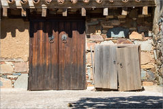 Vintage balcony with wooden door and stoned wall Royalty Free Stock Images